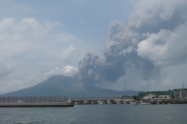 Ash plume rising out of the Sakurajima volcano near Kagoshima in Japan caused by a small explosive eruption