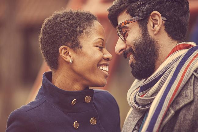 bi-racial couple smiling