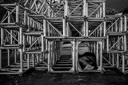 Human figure sleeping in scaffolding