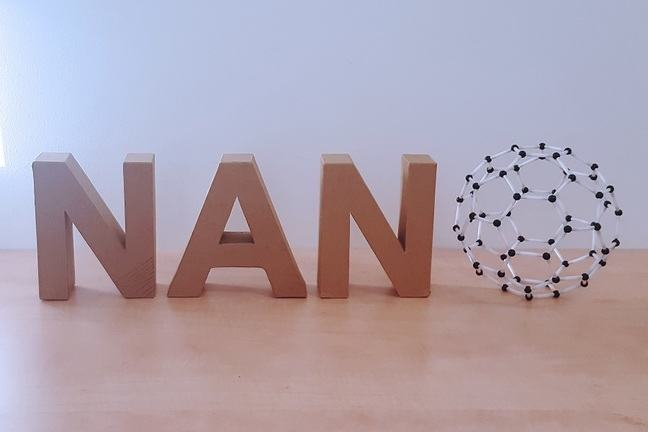 NANO: The letters NAN in 3D and the letter O as Buckey ball.