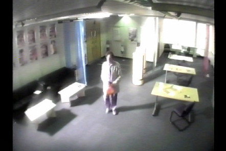 CCTV shot of man in an office