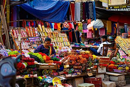 A small shop on the streets of Delhi, India with a range of goods on sale.