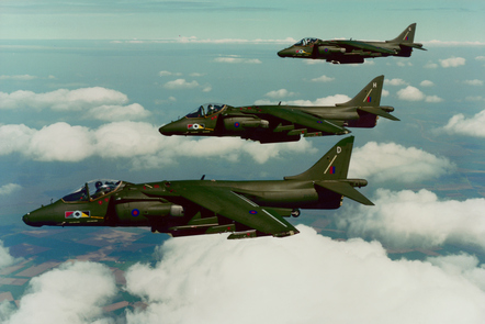 Three late mark Harrier IIs flying in formation.
