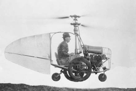 Black and white photograph of Jess Dixon in a car with a helicopter propeller from 1940.