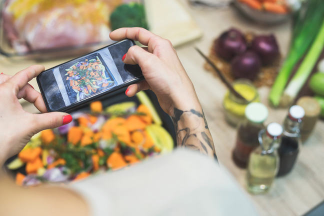 Foodie taking photo of food to share on social media.