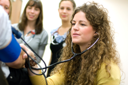 A student using a stethoscope