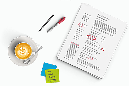 Annotated CV, surrounded by a cup of coffee and post-it notes.
