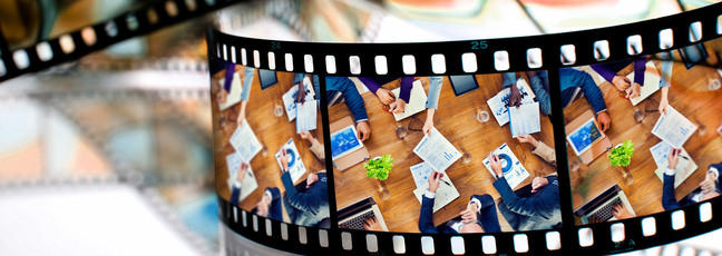Film roll with image of people sharing business ideas around a table