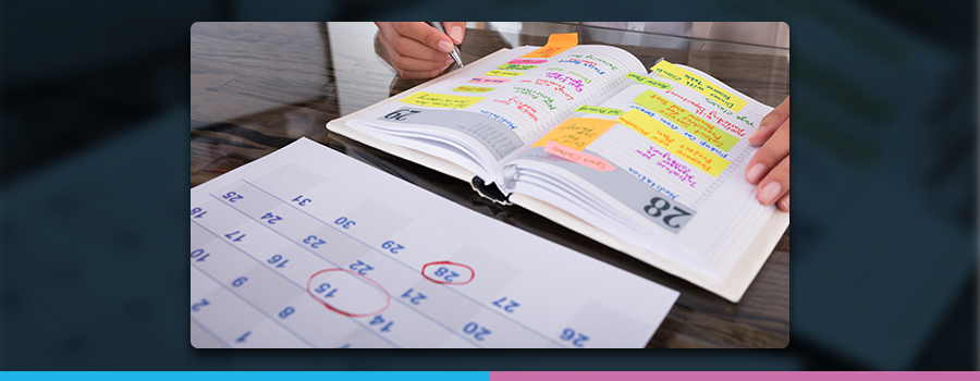 An image of a desk calendar and diary planner on a table