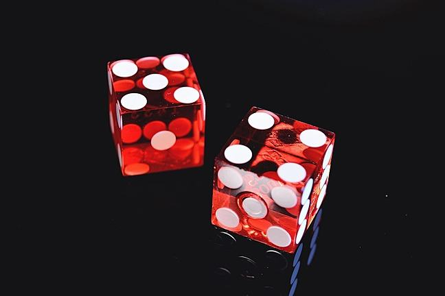 two red die sitting on a surface