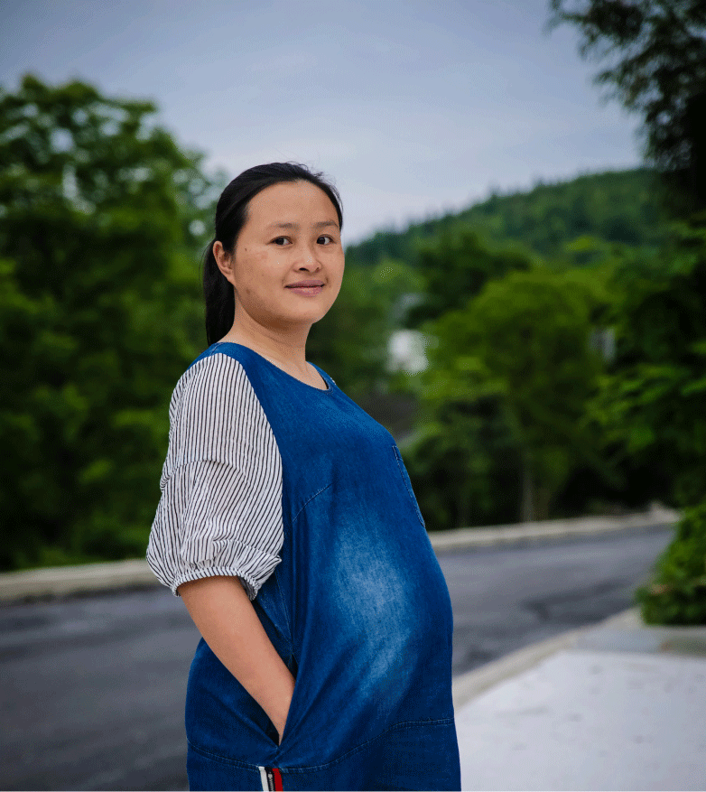 Image shows a young pregnant woman, Guizhou Province, China