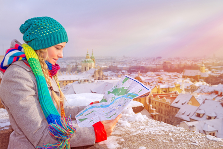 A girl holding a map in the snow