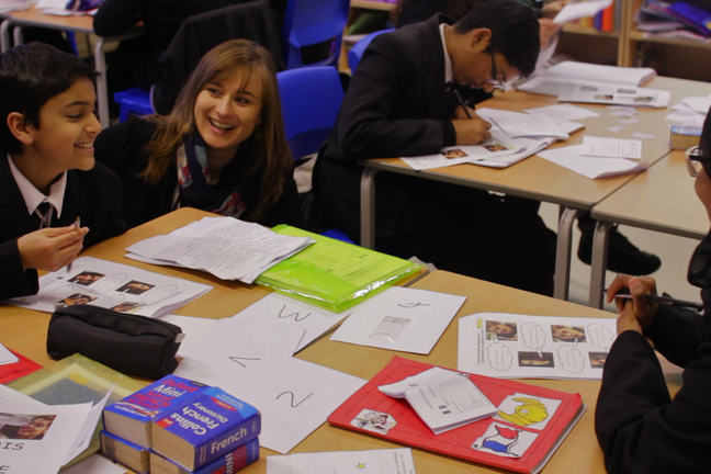 Image of Muriel Huet in the classroom supporting learners with language learning
