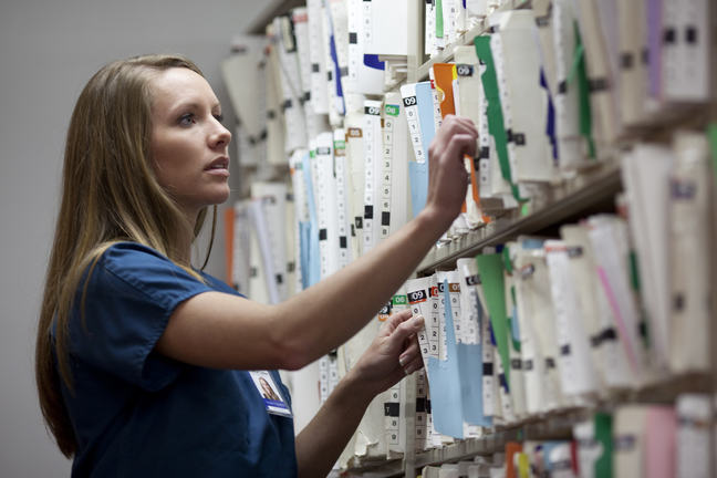 A nurse searching for medical records.