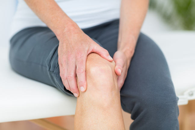 Woman having knee pain.