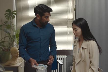 Gihan and Natsumi look at an evidence bag.