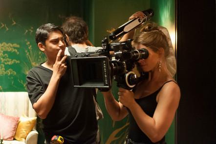 Camera operators film a scene