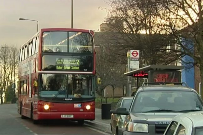 London Bus leaving a bus stop