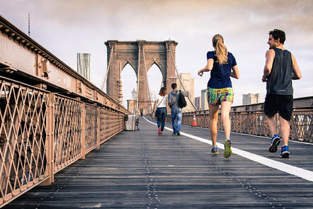2 people jogging in the city