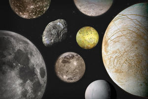 A collection of moons of different sizes and colours floating in space