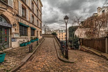 sharp turn in cobblestone road