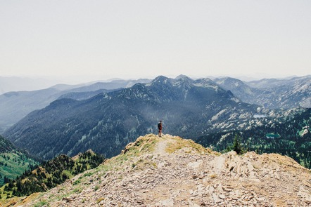 Image of person standing on a mountain top