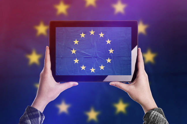 A pair of hands holding up a tablet with an EU flag on the screen