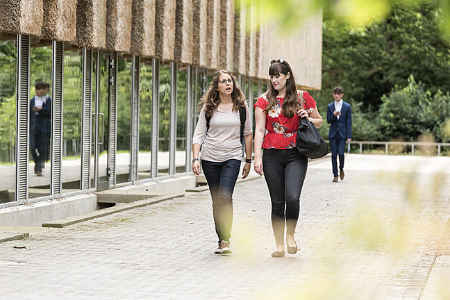 Students walking around university campus