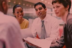 A group of business professionals managing a project