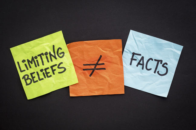 "Three postit notes reading ""Limiting beliefs does not equal facts"""