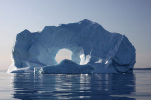 Iceberg floating in large, open body of water