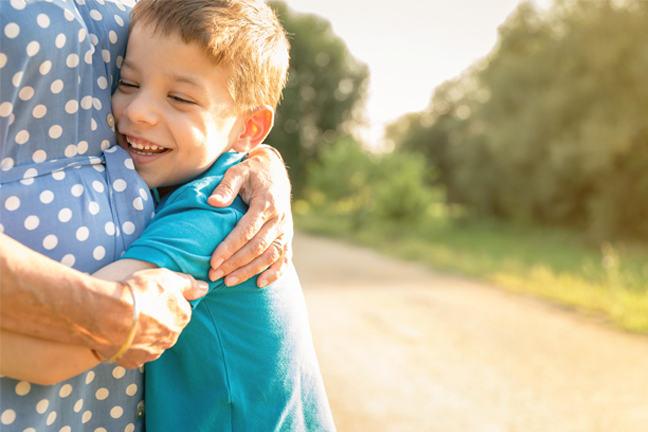 Boy hugging a woman