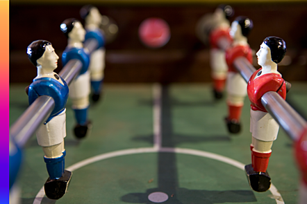 Blue and red figures in foosball table