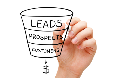Hand drawing a funnel with the words leads, prospects and customers leading to a dollar sign.