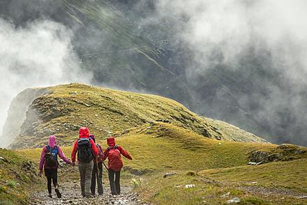 Group of people walking in the mountains.