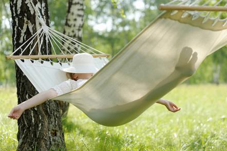 A woman lying in a hammock.