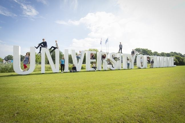 University of Twente logo with students sitting on top and inside the letters.
