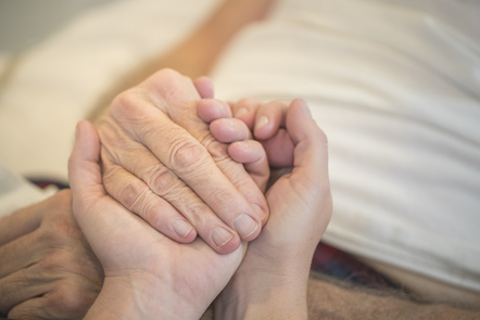 Young and old hands clasped