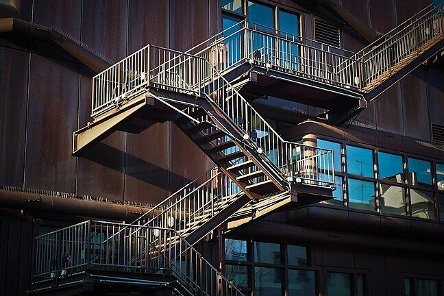 A finely structured external staircase going up several levels