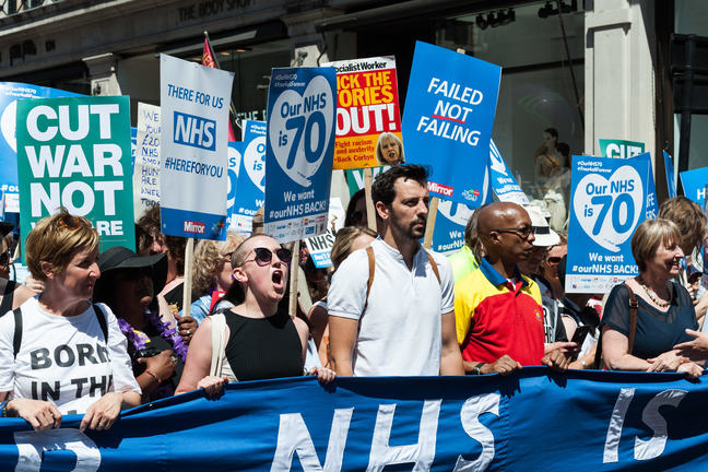 Demonstrators taking part in a march protesting to end austerity policies.