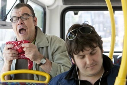 Man sneezing on bus: MARK THOMAS / SCIENCE PHOTO LIBRARY / Universal Images Group