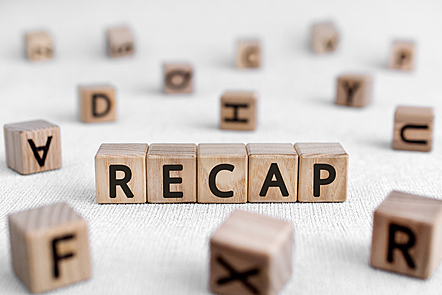RECAP - words from wooden blocks with letters stock photo