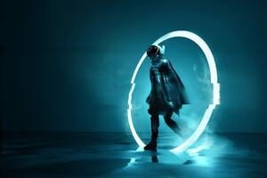 A model wearing a futuristic outfit on a neon background