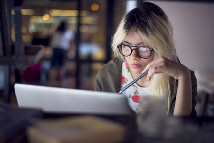Woman deep in thought at laptop