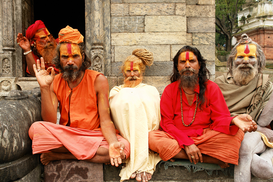 Five holy men in India sitting