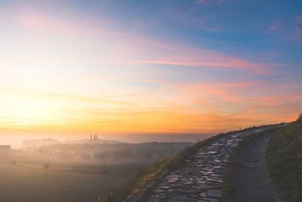 Stone path with colourful sunrise overhead