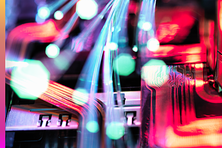 Photographic image of fibre optics carrying data over electric wires