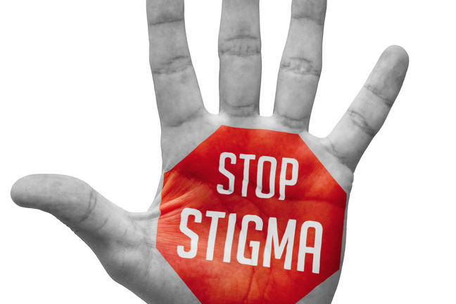 "Hand with ""Stop stigma"" written on the palm"