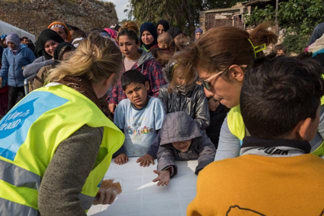 Breakfast line in Souda refugee camp on Greek Island Chios