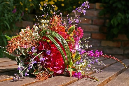 A colourful bouquet of flowers sitting on a table